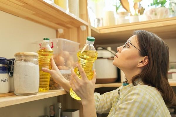 Woman stocking her pantry.