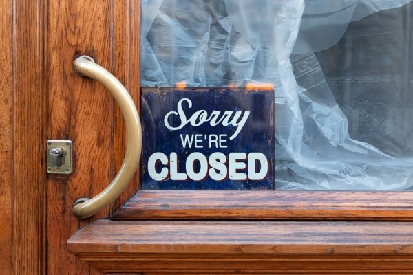 Business entry door with closed sign.