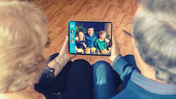 Senior couple in a video conference using a tablet.